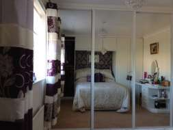 Mirror sliding wardrobe doors with polished silver frames