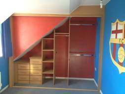A custom built wardrobe interior built to maximise the use of an awkward space