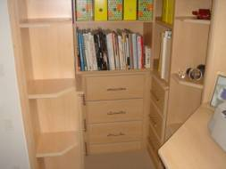 Bookcase fitted into alcove (view of the drawers)